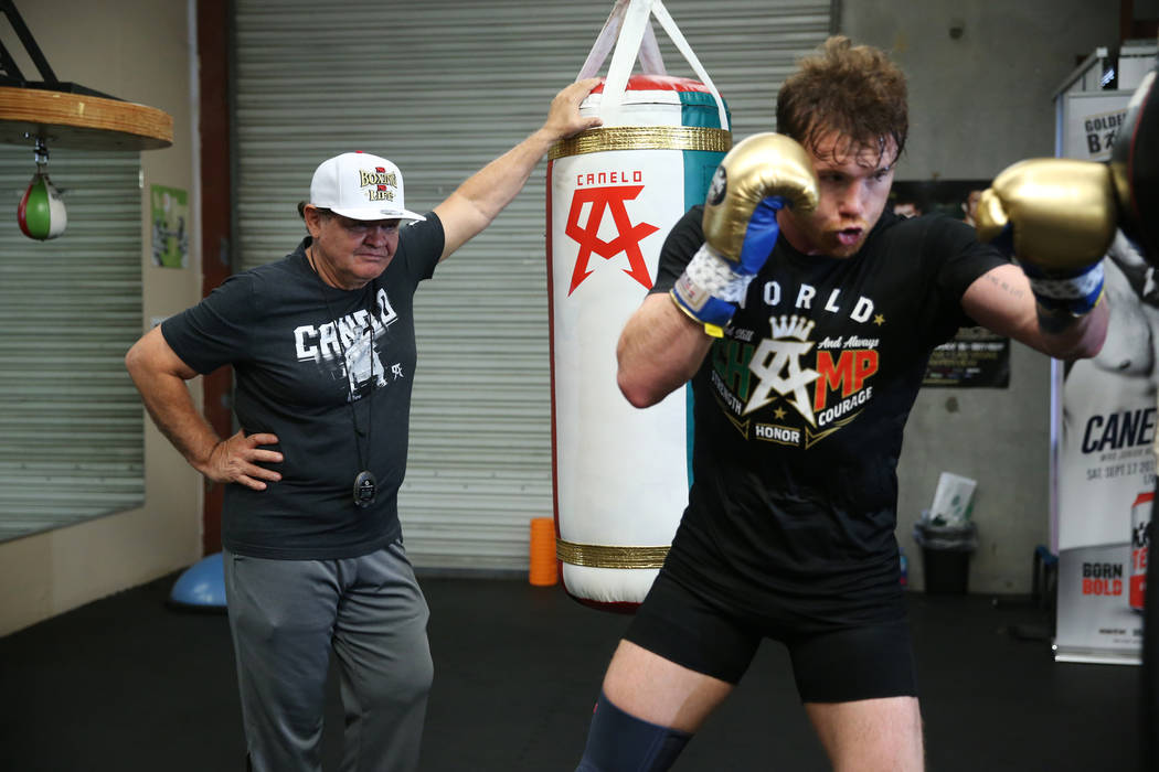 "Boxer Saul ""Canelo"" Alvarez, right, works out as his trainer Jose ""Chepo"" Reynoso looks on at his gym in San Diego, Calif., Friday, July 27, 2018. Erik Verduzco Las Vegas Revie ..."
