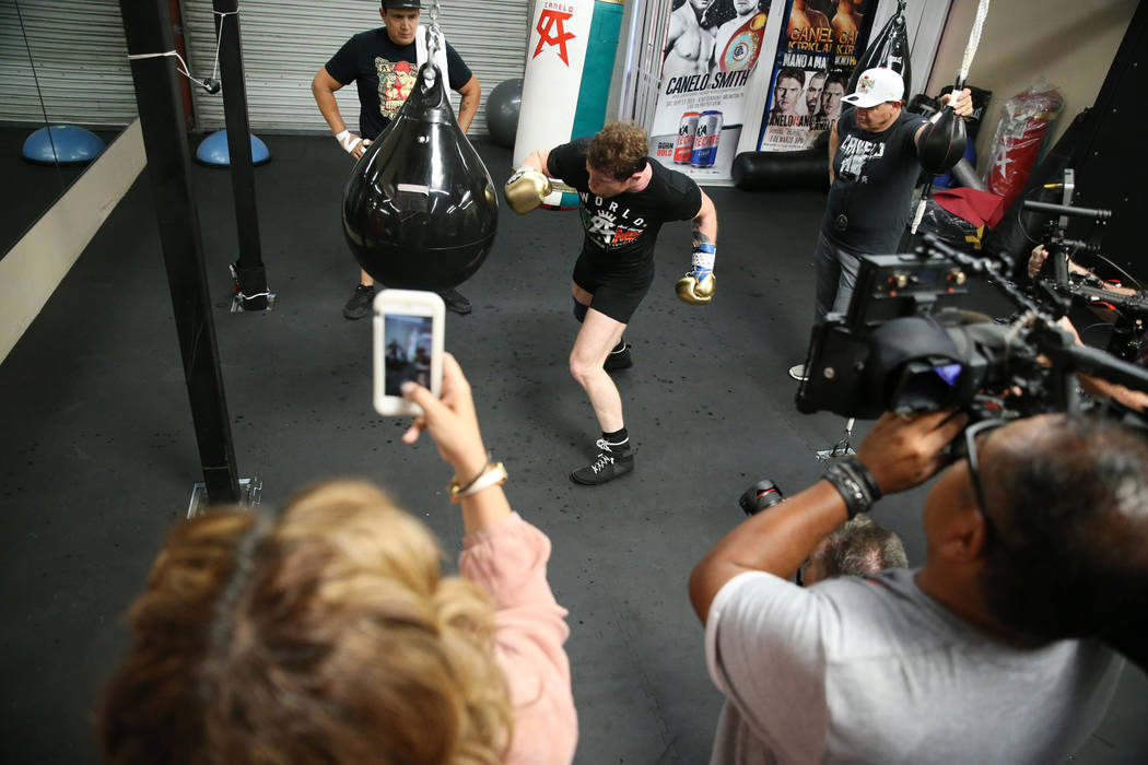 "Saul ""Canelo"" Alvarez, center, hits the bag during his workout at his gym in San Diego, Calif., Friday, July 27, 2018. Erik Verduzco Las Vegas Review-Journal @Erik_Verduzco"