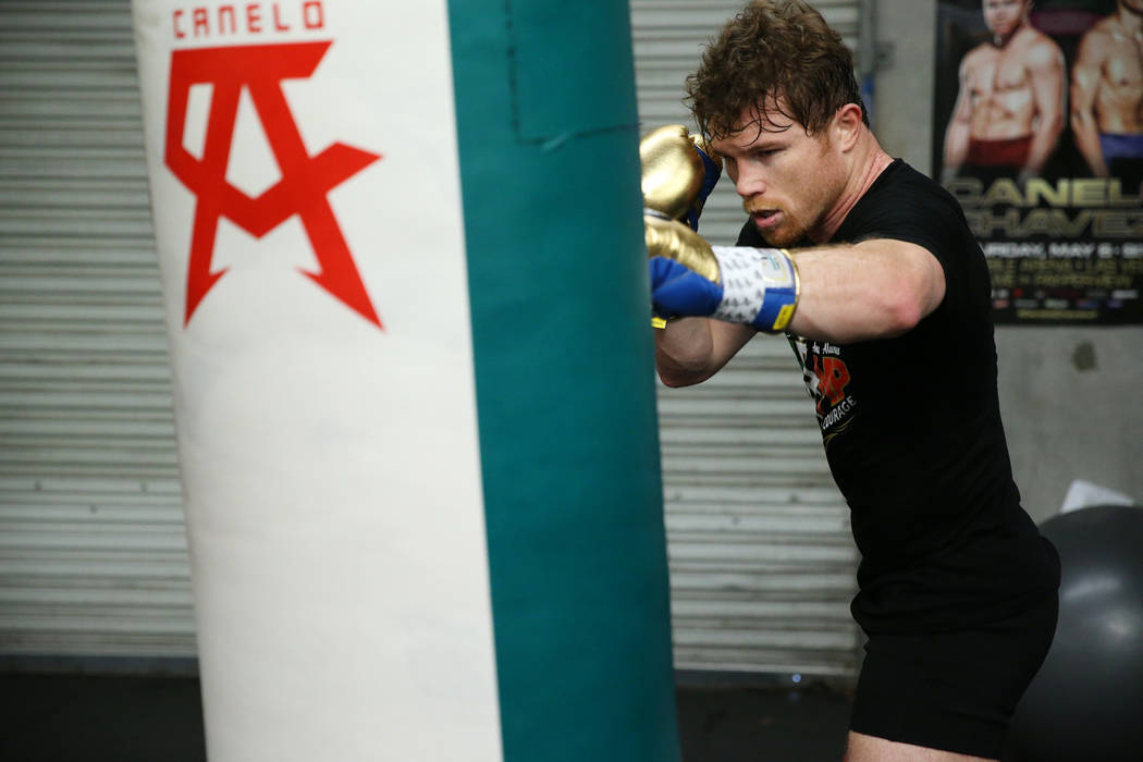 "Saul ""Canelo"" Alvarez hits the bag during his workout at his gym in San Diego, Calif., Friday, July 27, 2018. Erik Verduzco Las Vegas Review-Journal @Erik_Verduzco"