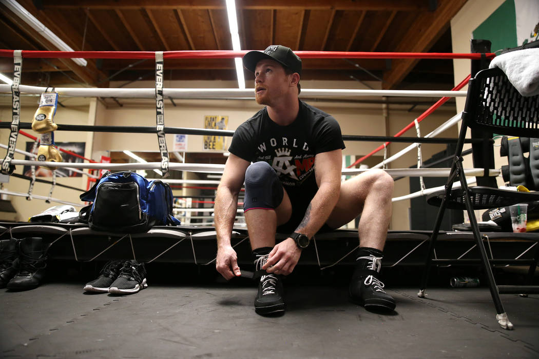 "Saul ""Canelo"" Alvarez ties his shoes before a workout at his gym in San Diego, Calif., Friday, July 27, 2018. Erik Verduzco Las Vegas Review-Journal @Erik_Verduzco"
