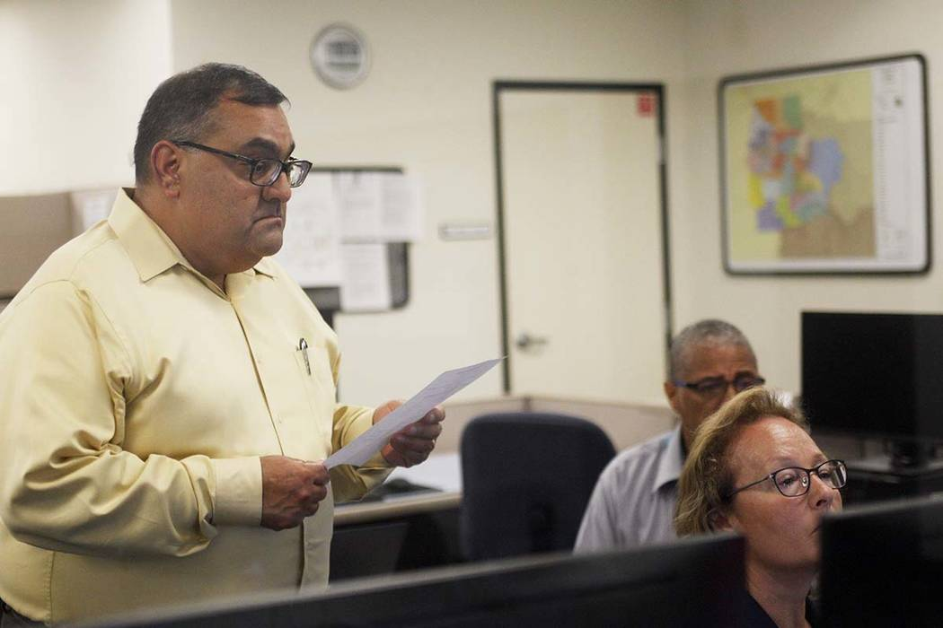 Joe Gloria, the county registrar of voters, looks over Program Supervisor Kelly Fisher's shoulders in the tabulation room after initial results come in for the redo election for the Republican pri ...