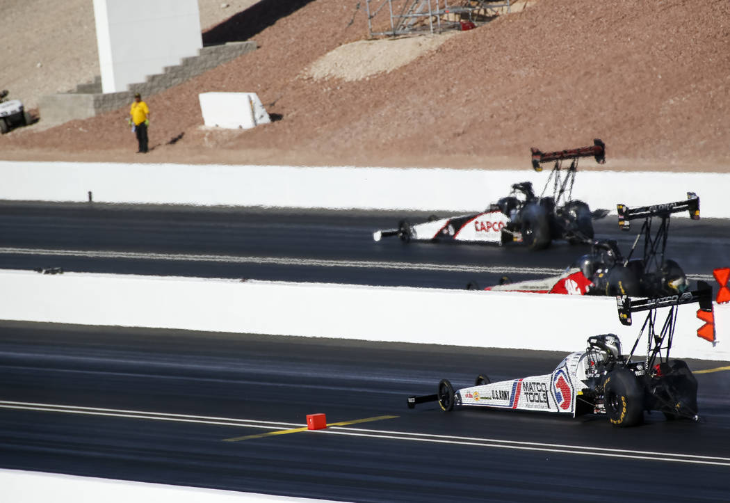 Top Fuel drivers, from top to bottom, Steve Torrence, Doug Kalitta, Antron Brown and Tony Schumacher (not shown) compete in the final elimination race of the DENSO Spark Plug NHRA Four-Wide Nation ...
