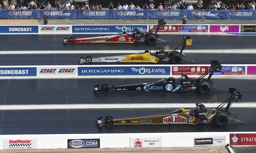 Top Fuel drivers, from above, Doug Kalitta, Richie Crampton, Scott Palmer and Leah Pritchett compete on the new four-wide track during the first day of qualifying for the DENSO Spark Plugs NHRA Na ...