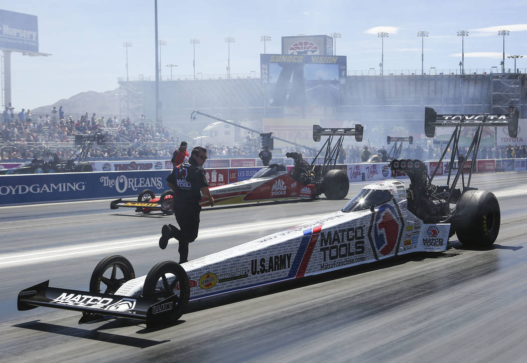 Top Fuel driver Antron Brown prepares to compete during the second day of qualifying for the DENSO Spark Plugs NHRA Nationals at The Strip at Las Vegas Motor Speedway in Las Vegas on Saturday, Apr ...
