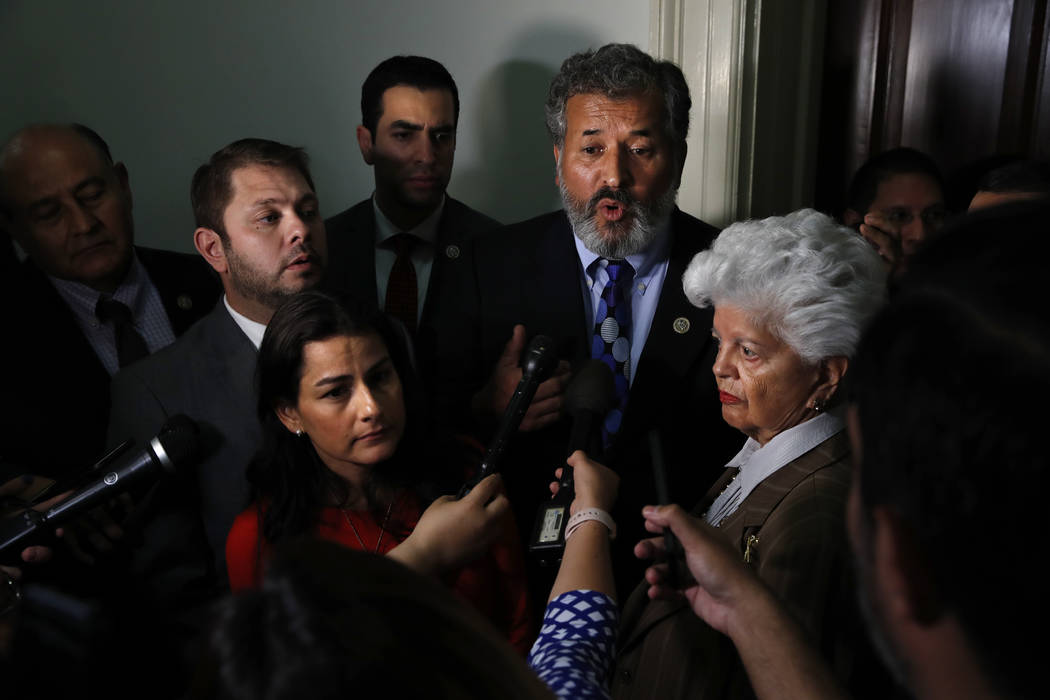 Rep. Juan Vargas, D-Calif., center, speaks about the Congressional Hispanic Caucus' meeting with Homeland Security Secretary Kirstjen Nielsen, Wednesday, July 25, 2018, on Capitol Hill in Washingt ...