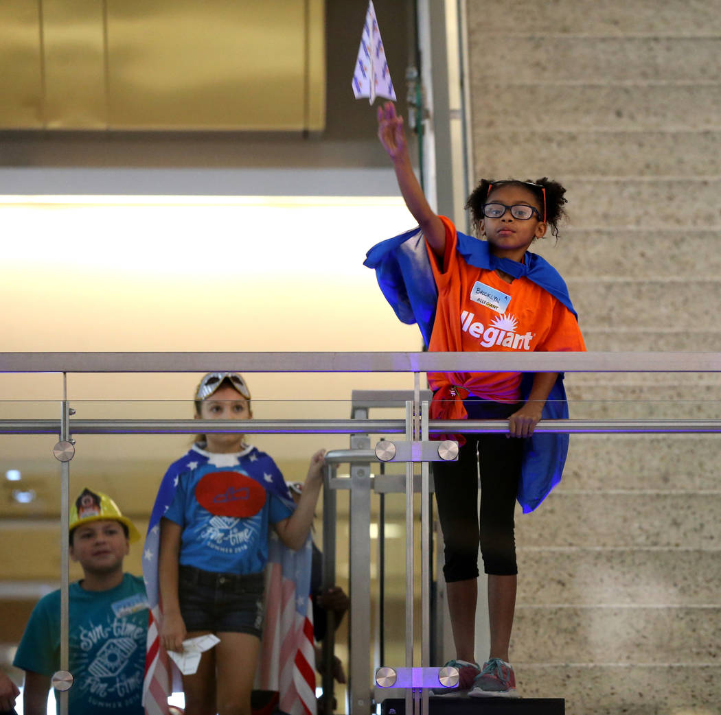 Brooklyn Lee, 9, competes in the distance competition during the Sixth Annual Paper Plane Palooza in Terminal 3 at McCarran International Airport in Las Vegas Wednesday, July 25, 2018. More than 7 ...