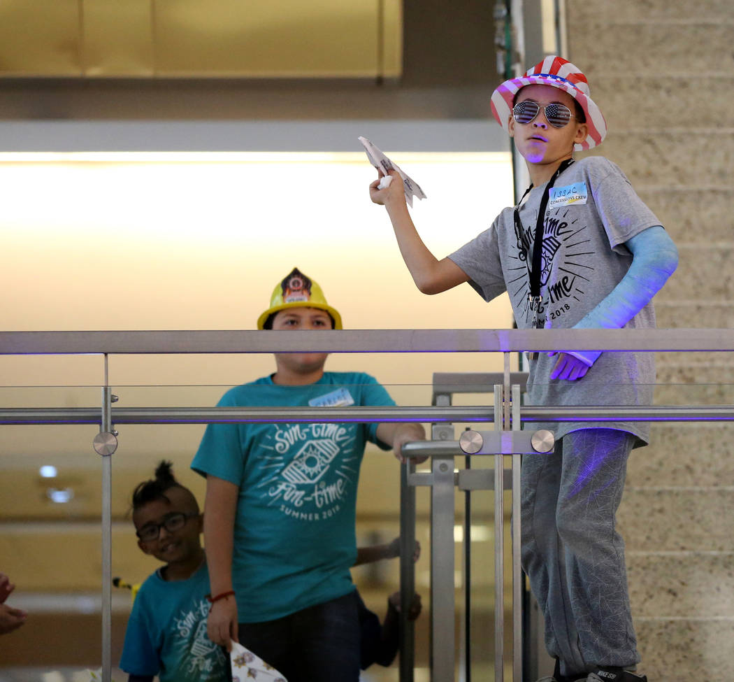 Issac Morton competes in the distance competition during the Sixth Annual Paper Plane Palooza in Terminal 3 at McCarran International Airport in Las Vegas Wednesday, July 25, 2018. More than 70 ch ...