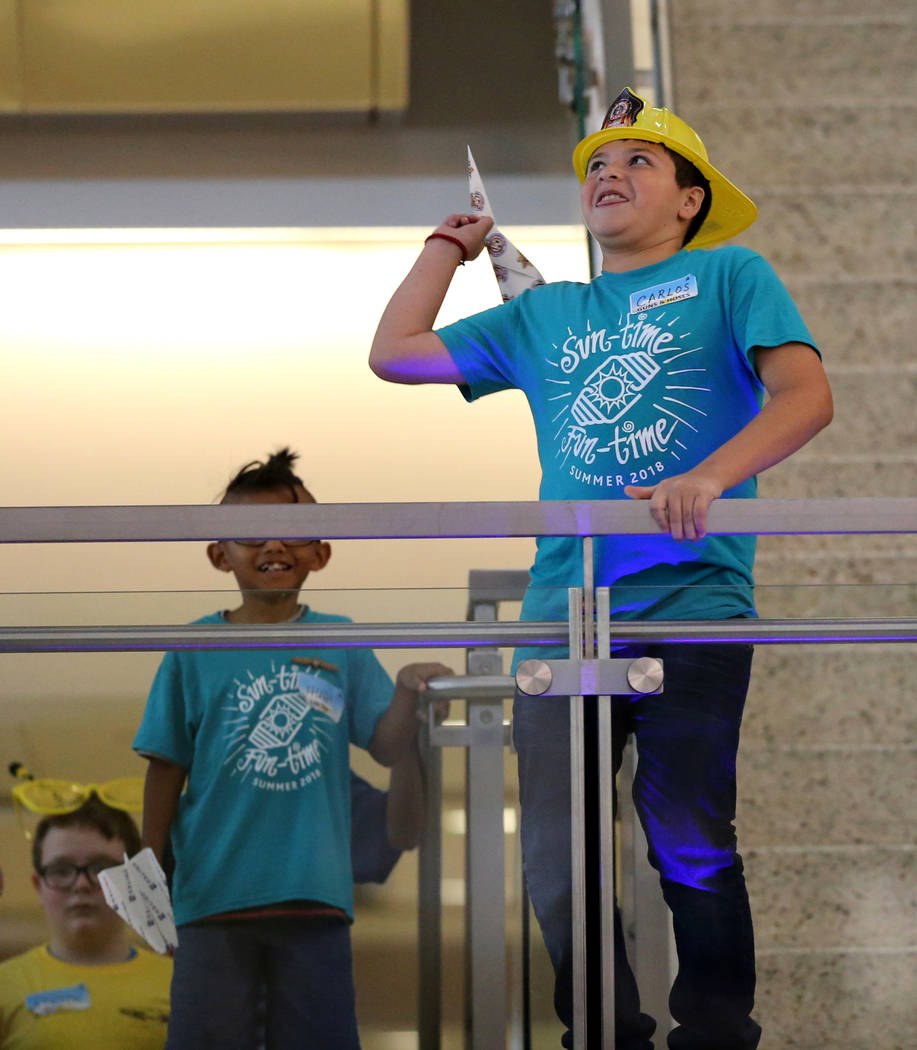 Carlos Padilla, 12, competes in the distance competition during the Sixth Annual Paper Plane Palooza in Terminal 3 at McCarran International Airport in Las Vegas Wednesday, July 25, 2018. More tha ...