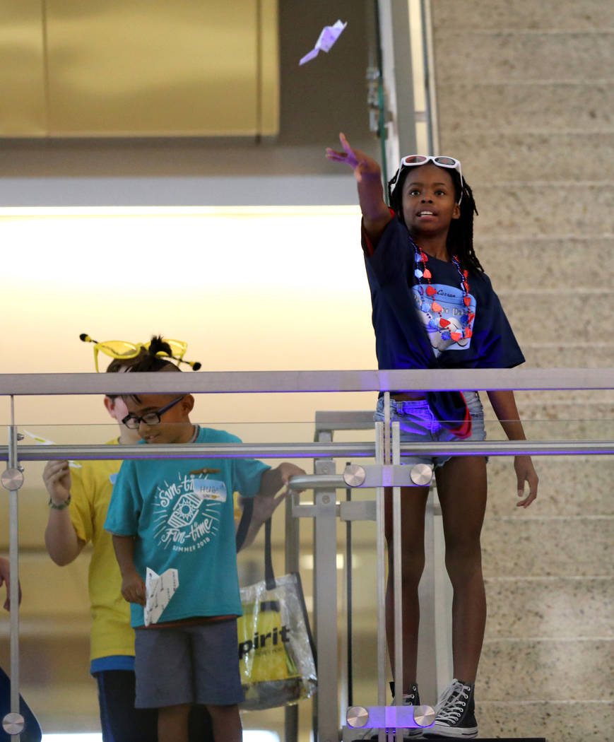 Zoey competes in the distance competition during the Sixth Annual Paper Plane Palooza in Terminal 3 at McCarran International Airport in Las Vegas Wednesday, July 25, 2018. More than 70 children f ...