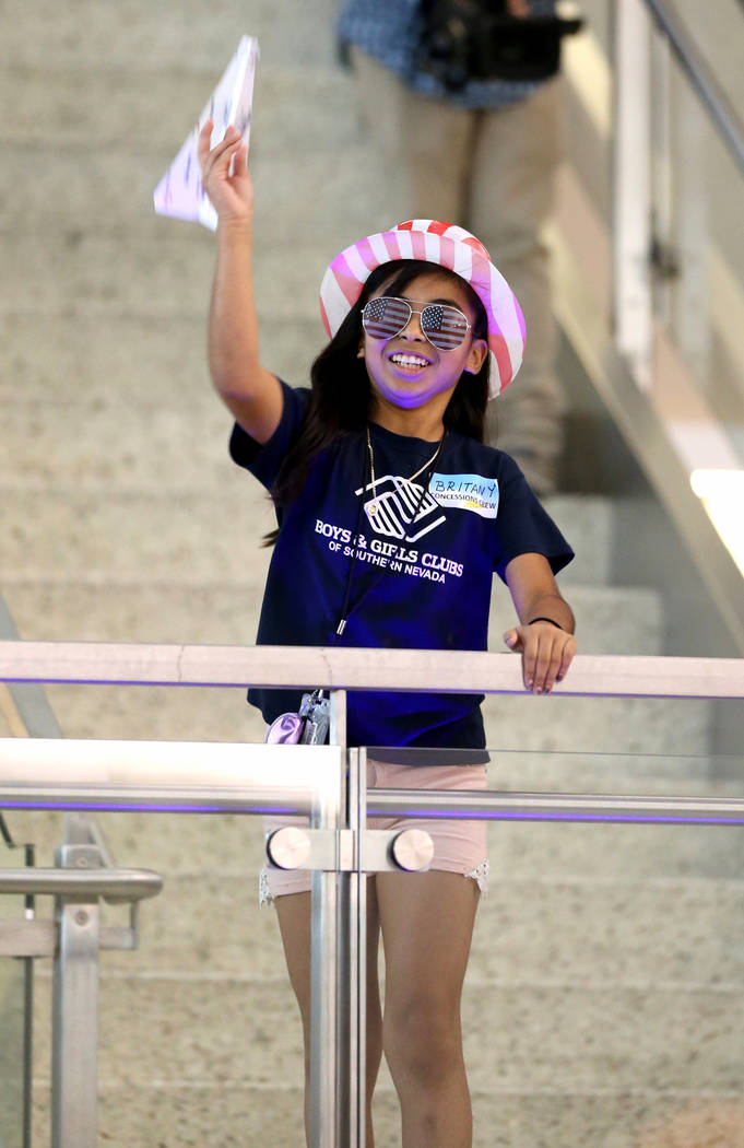Britany Gutierrez competes in the distance competition during the Sixth Annual Paper Plane Palooza in Terminal 3 at McCarran International Airport in Las Vegas Wednesday, July 25, 2018. More than ...