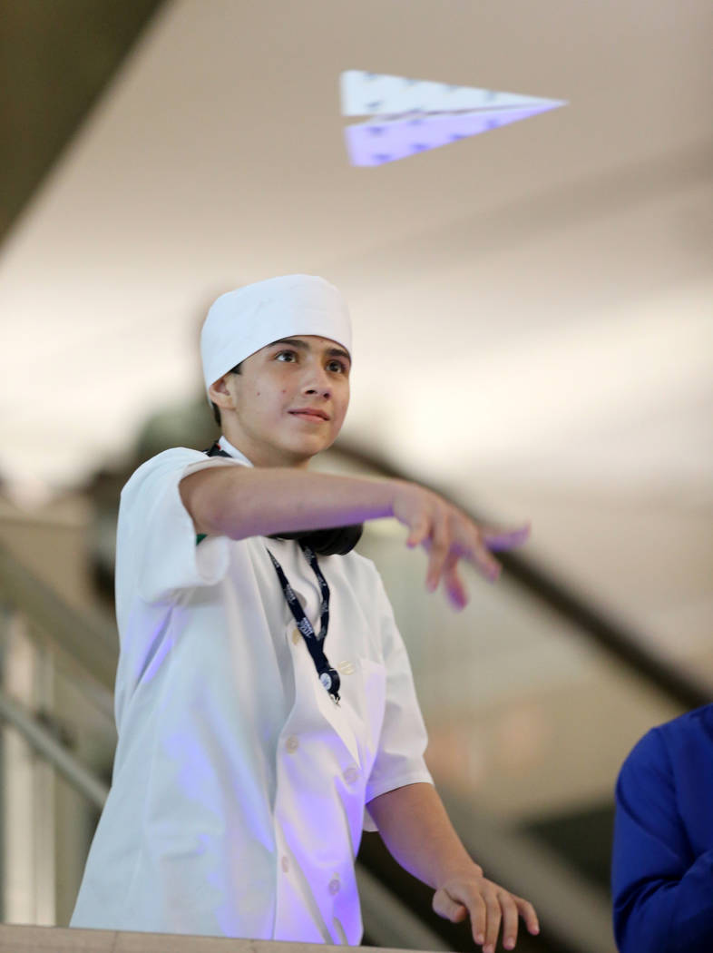 Jahan Sarshar competes in the distance competition during the Sixth Annual Paper Plane Palooza in Terminal 3 at McCarran International Airport in Las Vegas Wednesday, July 25, 2018. More than 70 c ...