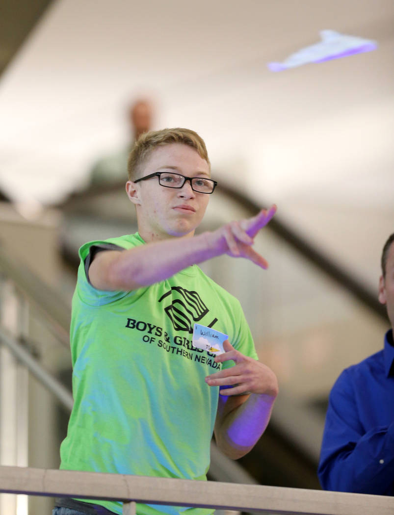 Willian Richardson, 15, competes in the distance competition during the Sixth Annual Paper Plane Palooza in Terminal 3 at McCarran International Airport in Las Vegas Wednesday, July 25, 2018. More ...