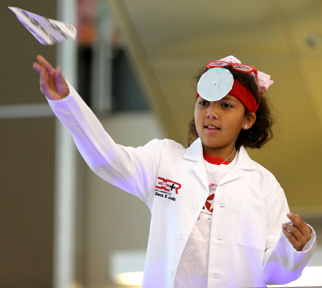Moriah Buchanan competes in the distance competition during the Sixth Annual Paper Plane Palooza in Terminal 3 at McCarran International Airport in Las Vegas Wednesday, July 25, 2018. More than 70 ...