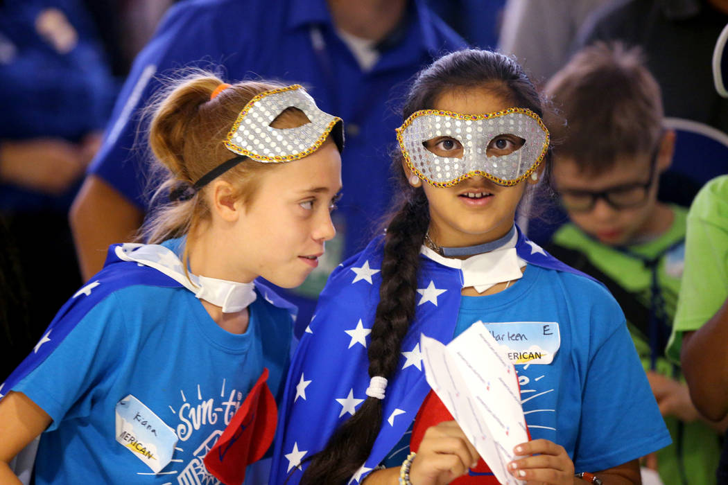 Kiana Harworth, left, and Harleen Kaur, both 11, strategize during the accuracy competition during the Sixth Annual Paper Plane Palooza in Terminal 3 at McCarran International Airport in Las Vegas ...