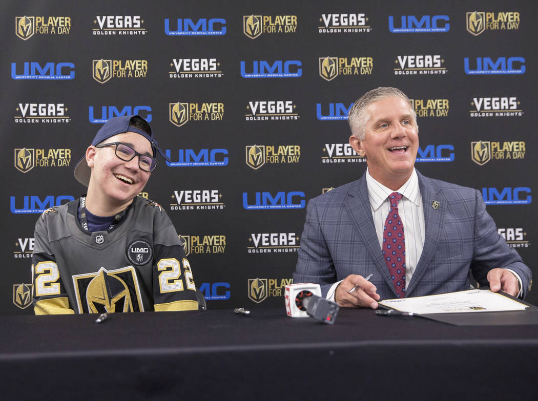 Nathaniel Cleveland, left, shares laugh with Golden Knights President Kerry Bubolz after signing his contract during UMC's Player for a Day event where pediatric patients get to experience a day ...