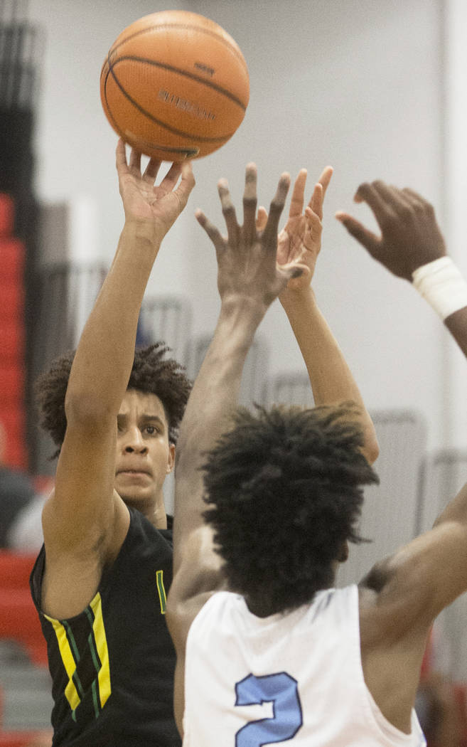 Las Vegas Prospects forward Jalen Hill (23) shoots over Seattle Rotary's Jaden McDaniels (2) in the first half during the Made Hoops Summer Showcase on Wednesday, July 25, 2018, at Liberty High Sc ...