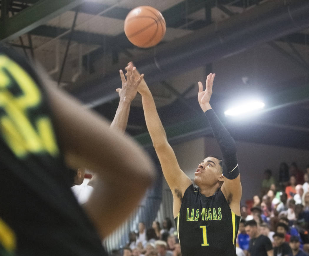 Las Vegas Prospects guard Julian Strawther (1) shoots a corner jump shot in the first half during his game against the Seattle Rotary at the Made Hoops Summer Showcase on Wednesday, July 25, 2018, ...
