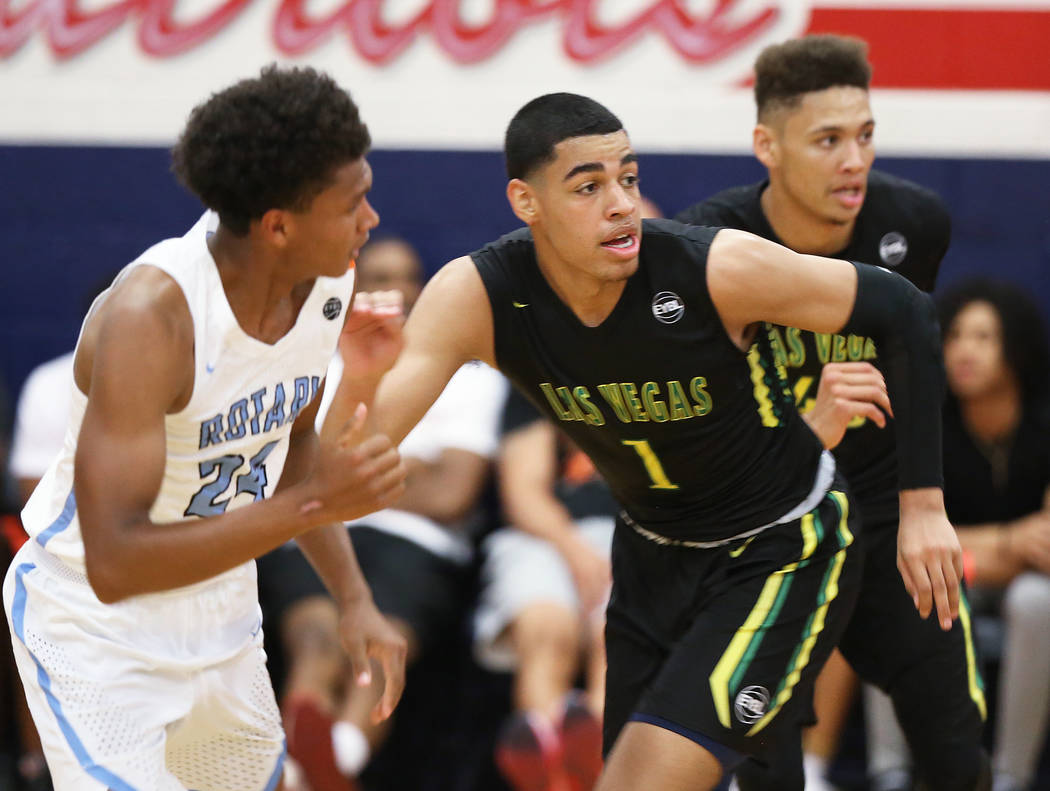Las Vegas Prospects guard Julian Strawther (1) sprints up court past Seattle Rotary guard RaeQuan Battle (24) in the first half during the Made Hoops Summer Showcase on Wednesday, July 25, 2018, a ...