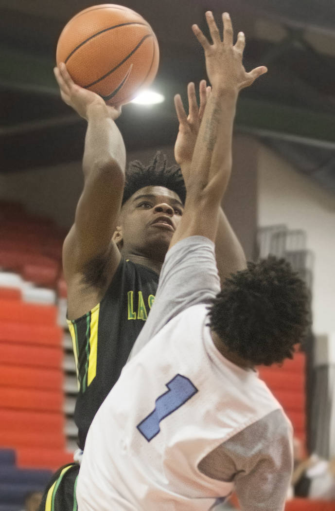 Las Vegas Prospects point guard Jaden Hardy (3) shoots over Seattle Rotary guard Kenneth Curtis (1) in the first half during the Made Hoops Summer Showcase on Wednesday, July 25, 2018, at Liberty ...