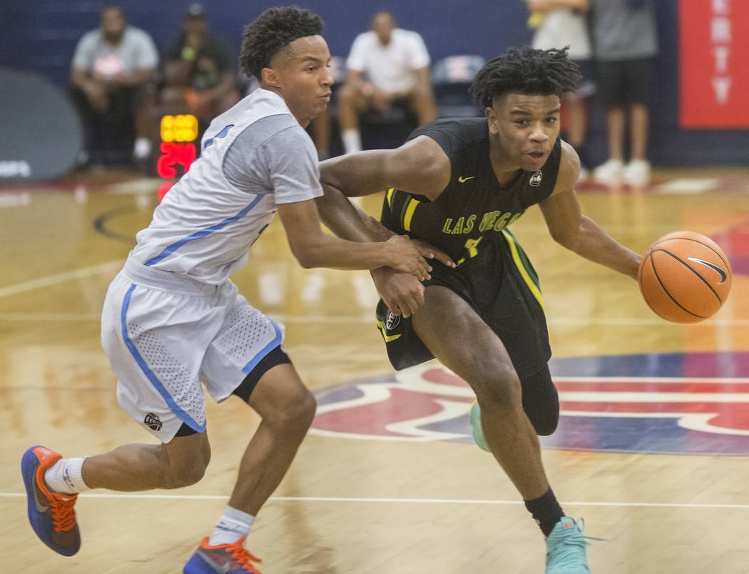 Las Vegas Prospects point guard Jaden Hardy (3) drives past Seattle Rotary guard Kenneth Curtis (1) in the first half during the Made Hoops Summer Showcase on Wednesday, July 25, 2018, at Liberty ...