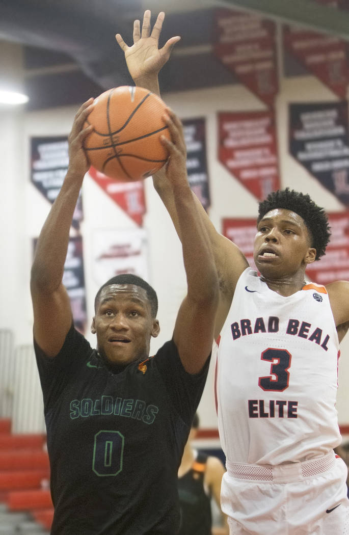 Oakland Soldiers guard Gianni Hunt (0) drives past Bradley Beal Elite guard Caleb Love (3) in the first half during the Made Hoops Summer Showcase on Wednesday, July 25, 2018, at Liberty High Scho ...
