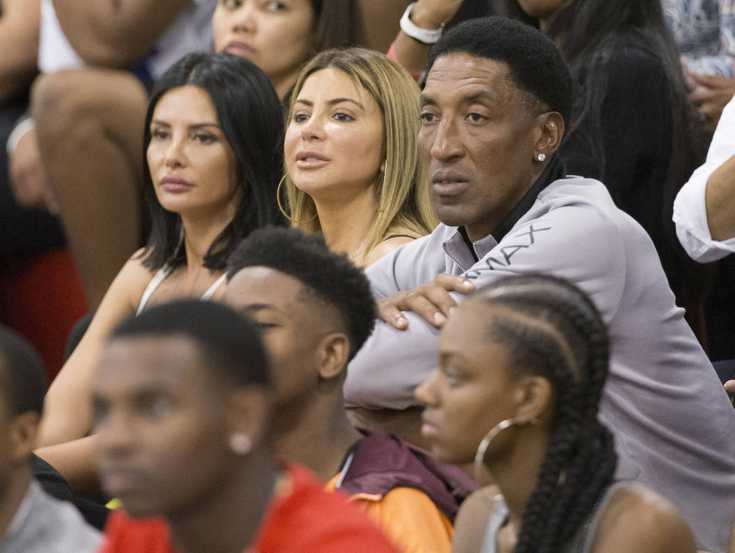 Scottie Pippin, right, a six-time NBA champion with the Chicago Bulls, watches his son compete in the Made Hoops Summer Showcase on Wednesday, July 25, 2018, at Liberty High School, in Las Vegas. ...