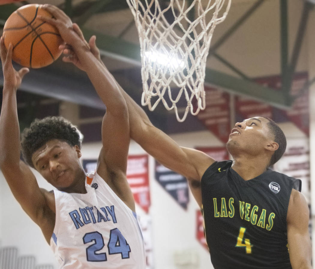 Las Vegas Prospects guard Jaxen Turner (4) fights for a rebound with Seattle Rotary guard RaeQuan Battle (24) in the first half during the Made Hoops Summer Showcase on Wednesday, July 25, 2018, a ...