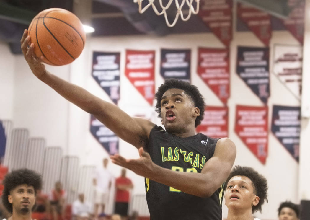 Las Vegas Prospects guard Joshua Christopher (32) drives past Seattle Rotary guard Kenneth Curtis (1) in the first half during the Made Hoops Summer Showcase on Wednesday, July 25, 2018, at Libert ...