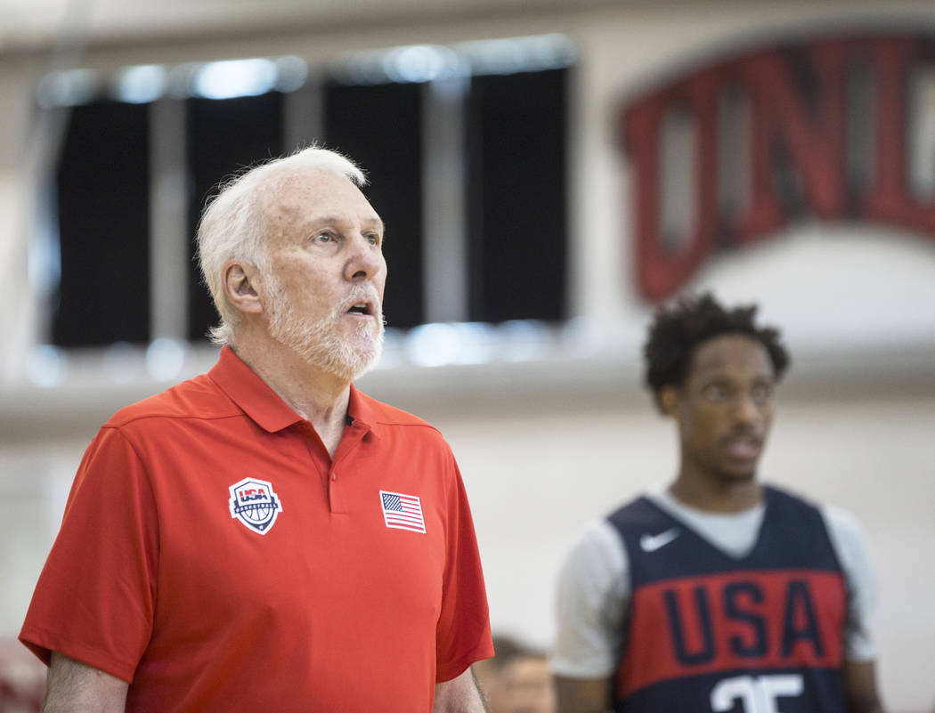Head coach Gregg Popovich, left, and San Antonio Spurs guard DeMar DeRozan (35) watch teammates during Team USA basketball's minicamp on Thursday, July 26, 2018, at the Mendenhall Center, in Las V ...