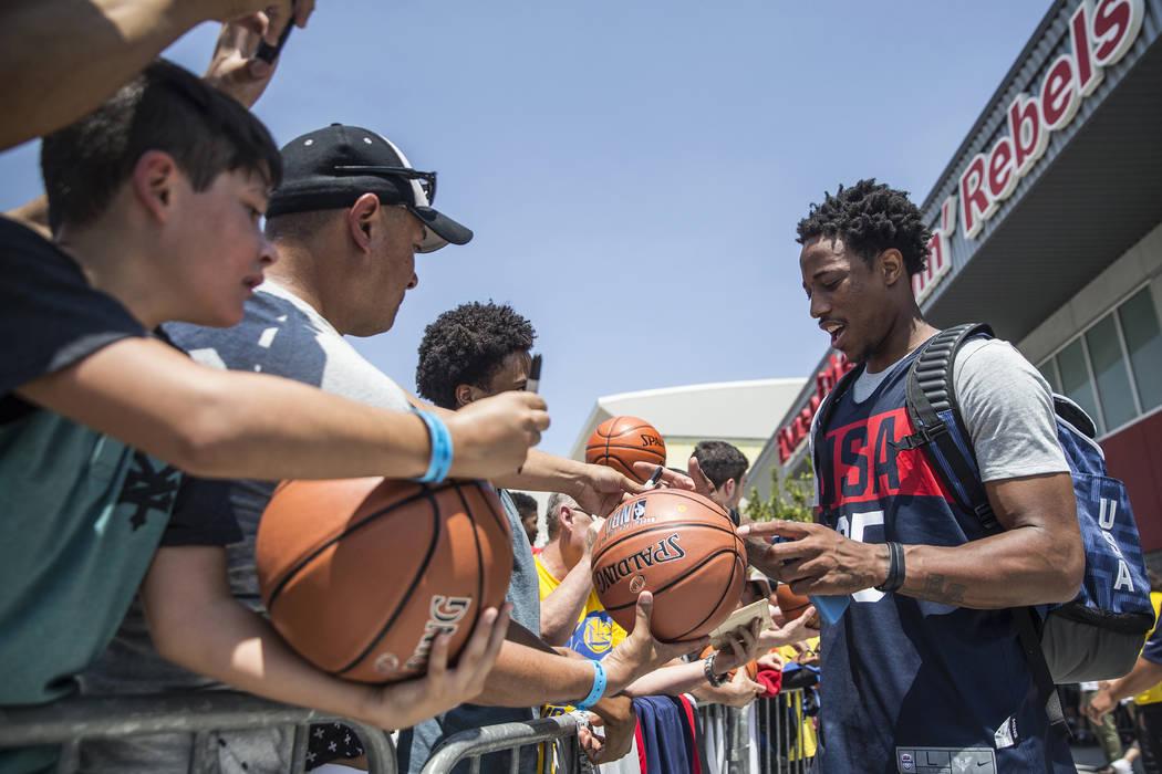 San Antonio Spurs guard DeMar DeRozan (35) signs autographs after Team USA basketball's minicamp on Thursday, July 26, 2018, at the Mendenhall Center, in Las Vegas. Benjamin Hager Las Vegas Review ...