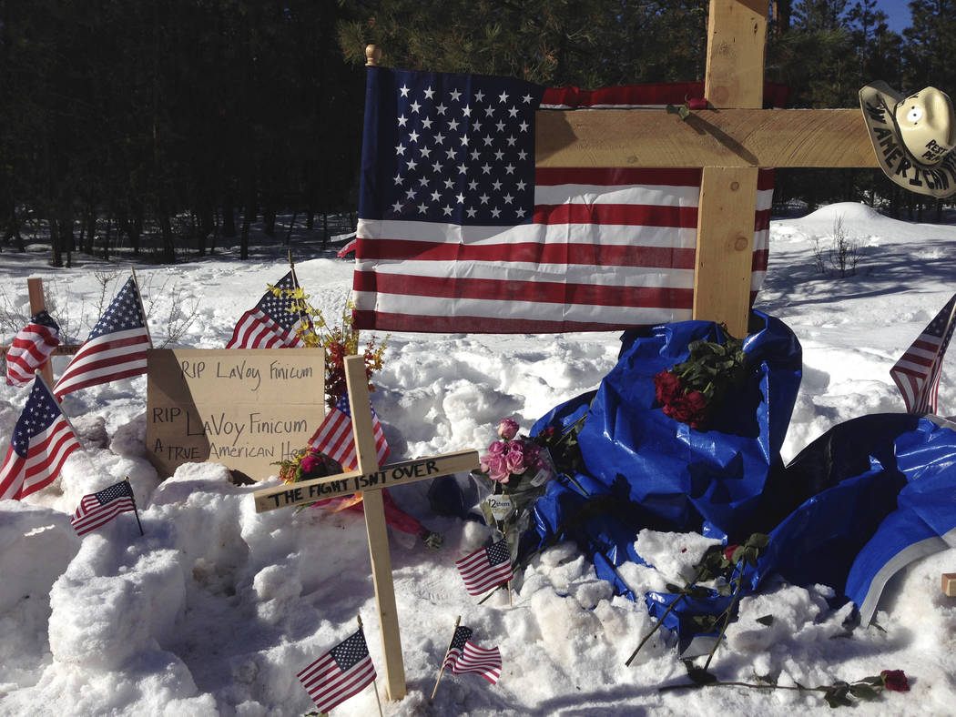 In this Jan. 31, 2016, file photo, makeshift roadside memorial for rancher LaVoy Finicum stands on a highway north of Burns, Ore. (AP Photo/Nick K. Geranios, File)