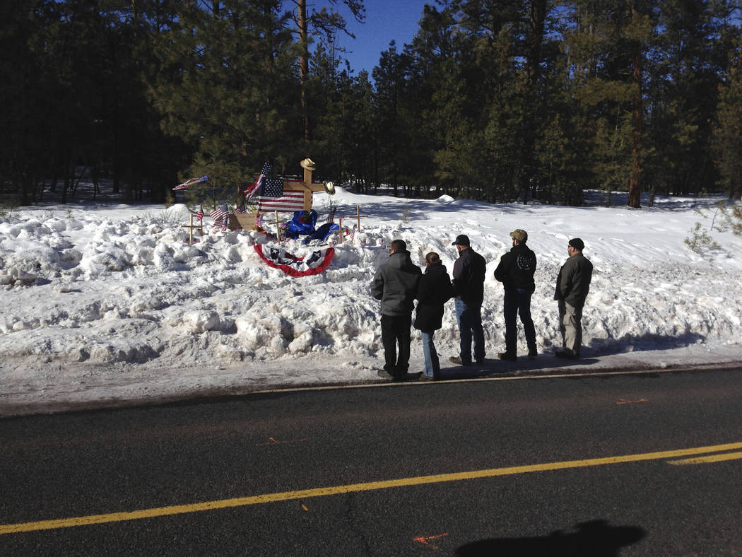 In this Jan. 21, 2016, file photo, mourners gather at roadside memorial for rancher LaVoy Finicum near Burns, Ore. (AP Photo/Nick K. Geranios, File)