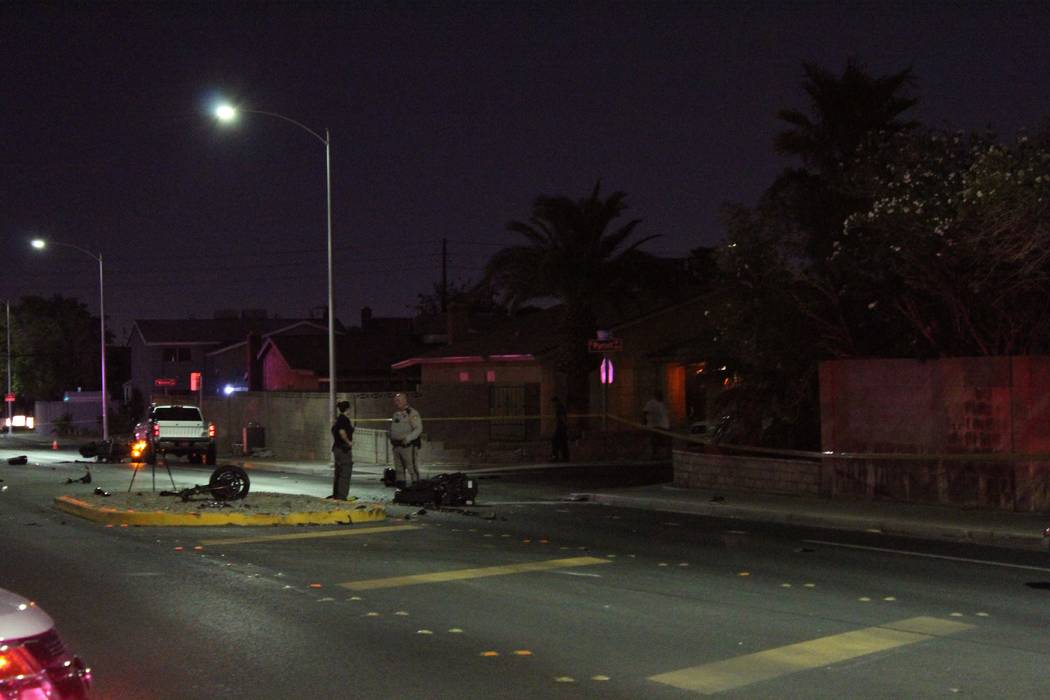 Police investigate two separate-but-related motorcycle accidents on Washington Avenue at Purcell Drive, near Rainbow Boulevard. (Max Michor/Las Vegas Review-Journal)