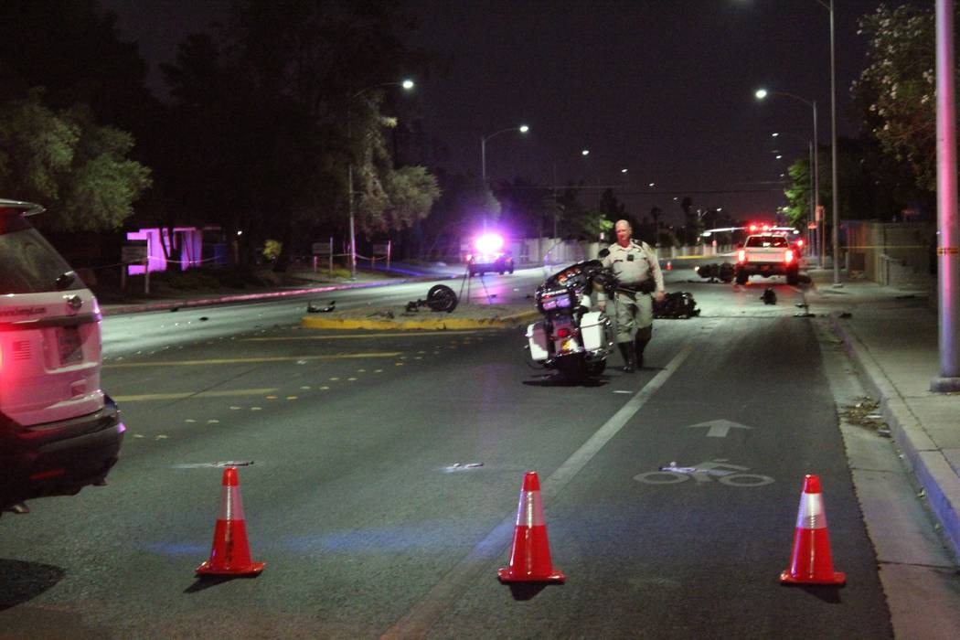 Police investigate two separate-but-related motorcycle accidents Wednesday, July 25, 2018, on Washington Avenue at Purcell Drive, near Rainbow Boulevard. (Max Michor/Las Vegas Review-Journal)