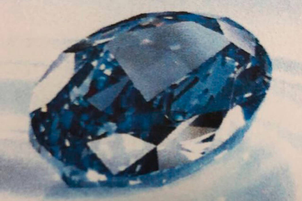 This undated photo from Dubai Police shows a rare blue diamond worth $20 million confiscated by Police in Dubai, United Arab Emirates. Dubai police say the rare diamond was stolen from a city comp ...