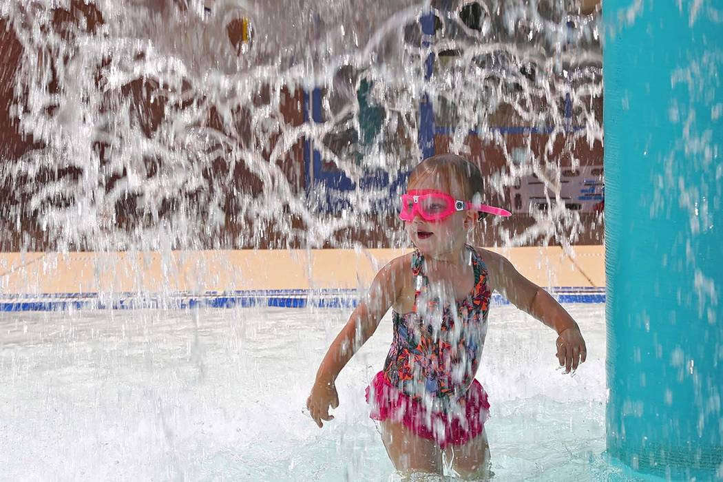 Dulcie Gunn, 4, plays in the water feature at Sunrise Park in Las Vegas. An excessive heat warning is in effective through Friday in Southern Nevada. (Rachel Aston/Las Vegas Review-Journal) @rooki ...