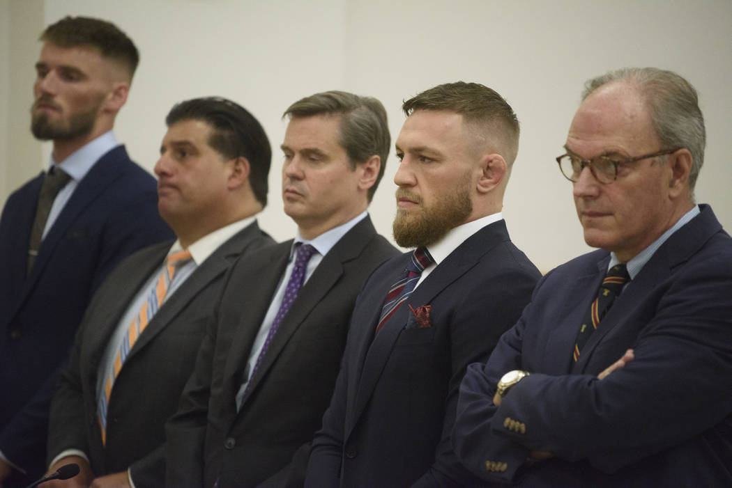 Mixed martial arts fighters Conor McGregor, second from right, and co-defendant Cian Cowley, left, appear in court, Thursday, July 26, 2018, in New York. McGregor pleaded guilty Thursday to disord ...