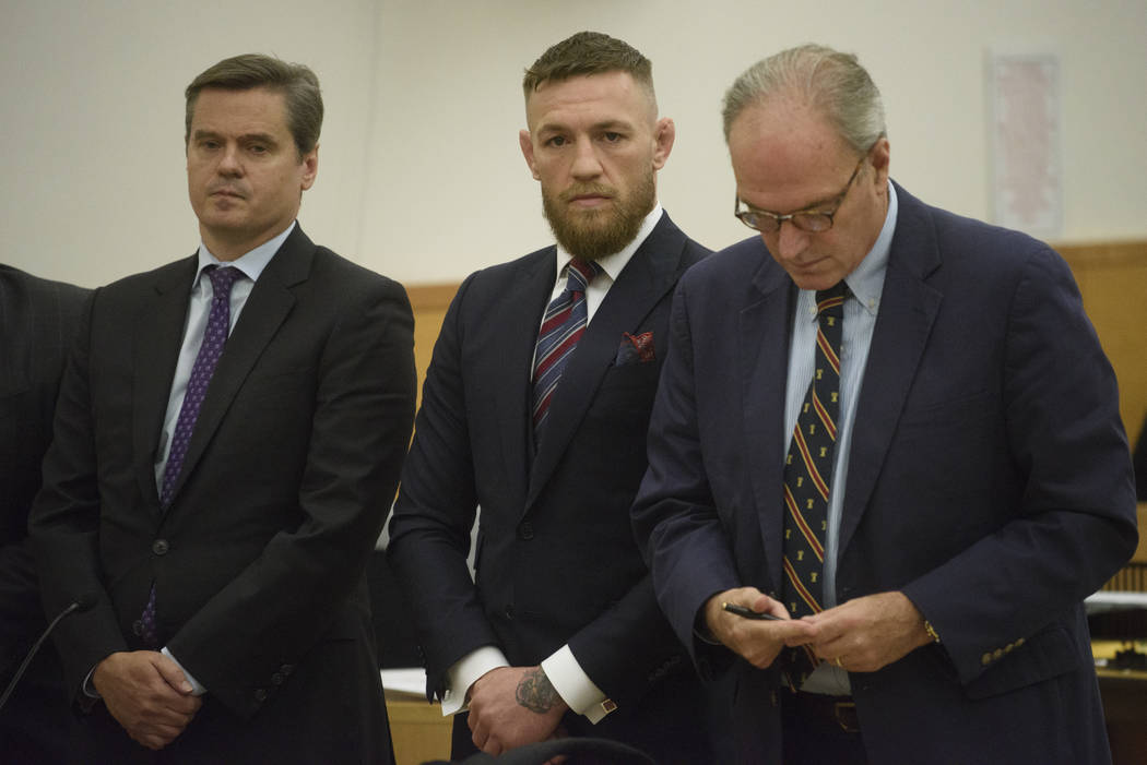 Mixed martial arts fighter Conor McGregor, center, appears in court, Thursday, July 26, 2018, in New York. McGregor pleaded guilty Thursday to disorderly conduct in exchange for community service ...