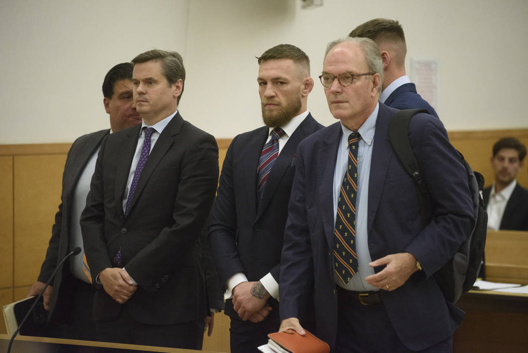 Mixed martial arts fighters Conor McGregor, center, appears in court, Thursday, July 26, 2018, in New York. McGregor pleaded guilty Thursday to disorderly conduct in exchange for community service ...