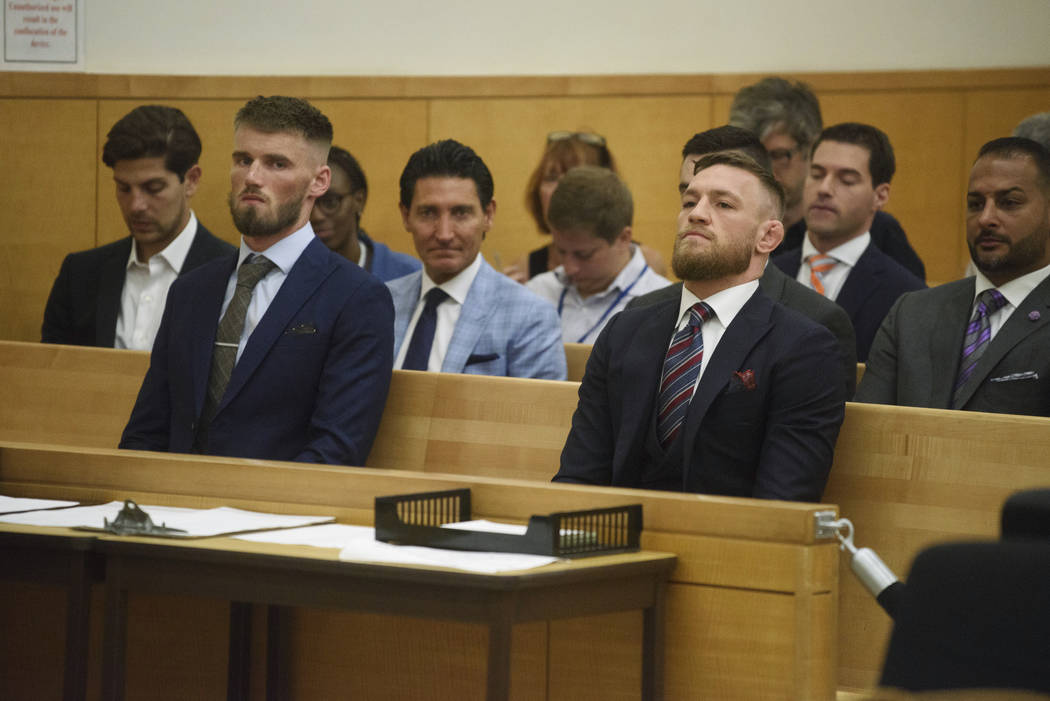 Conor McGregor, right, appears in court with co defendant Cian Cowley during a hearing, Thursday, July 26, 2018, in the Brooklyn borough of New York. The mixed martial arts star pleaded guilty Thu ...
