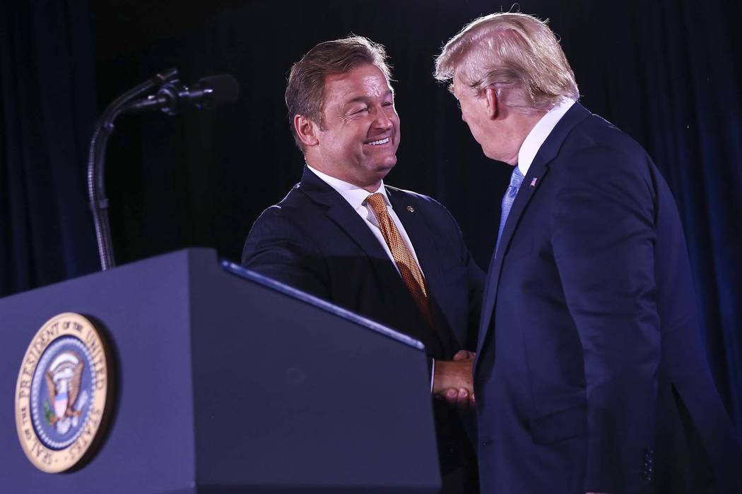 President Donald Trump, right, greets U.S. Sen. Dean Heller, R-Nev., during the keynote address at the Nevada Republican Party State Convention at the Suncoast in Las Vegas on Saturday, June 23, 2 ...