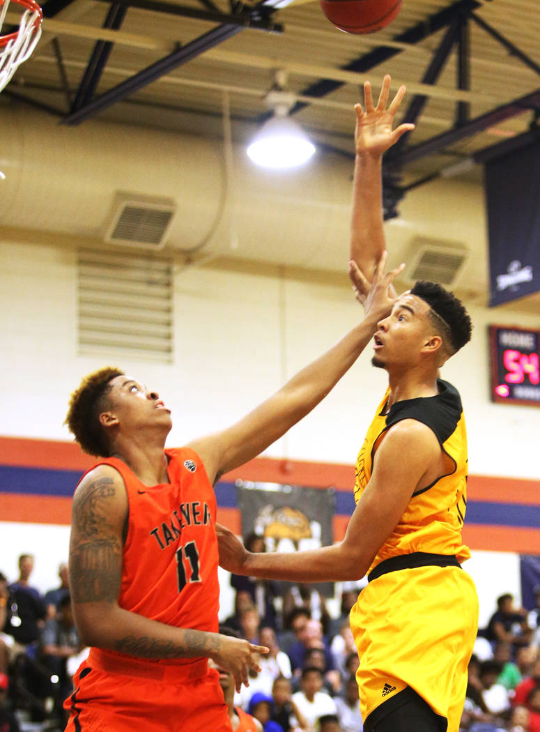 Compton Magic's Isaiah Mobley (15) attempts a basket against Bishop Gorman's Zaon Collins (11) at Bishop Gorman High School in Las Vegas, Wednesday, July 25, 2018. Rachel Aston Las Vegas Review-Jo ...