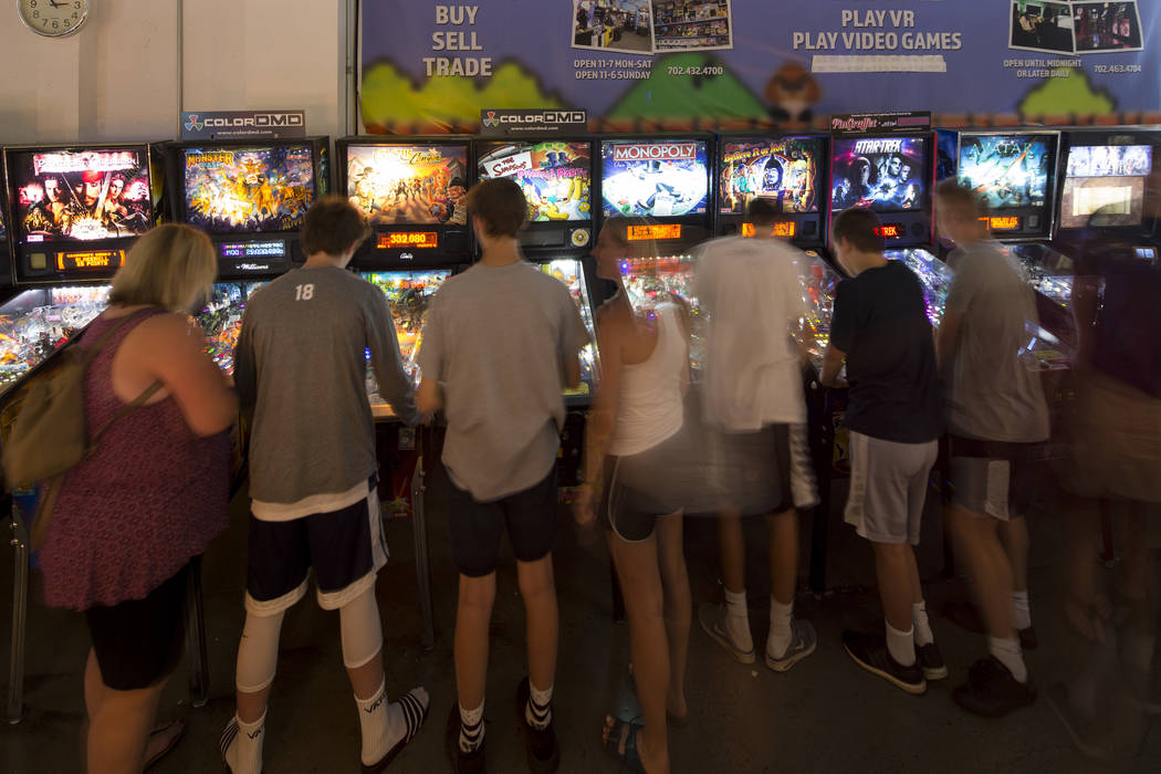 Patrons crowd a row of pinball machines at the Pinball Hall of Fame located at 1610 E. Tropicana Avenue in Las Vegas on Saturday, July 28, 2018. Richard Brian Las Vegas Review-Journal @vegasphotograph