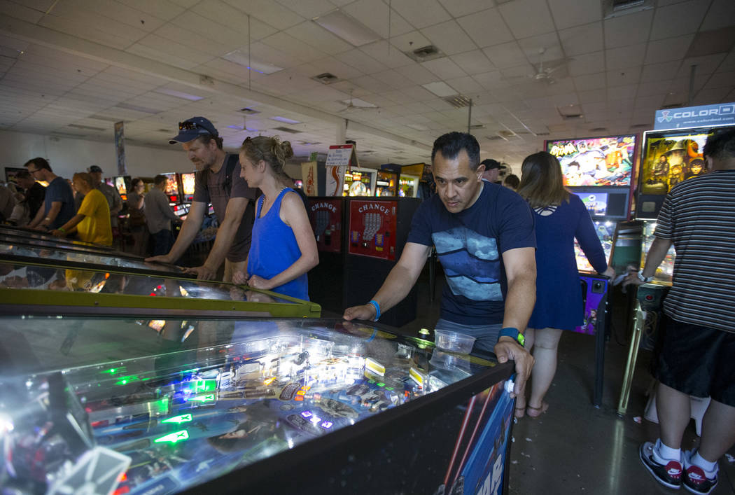 Joel Pastrana of Los Angeles, Calif., plays on a Star Wars pinball machine during a visit to the Pinball Hall of Fame located at 1610 E. Tropicana Avenue in Las Vegas on Saturday, July 28, 2018. R ...