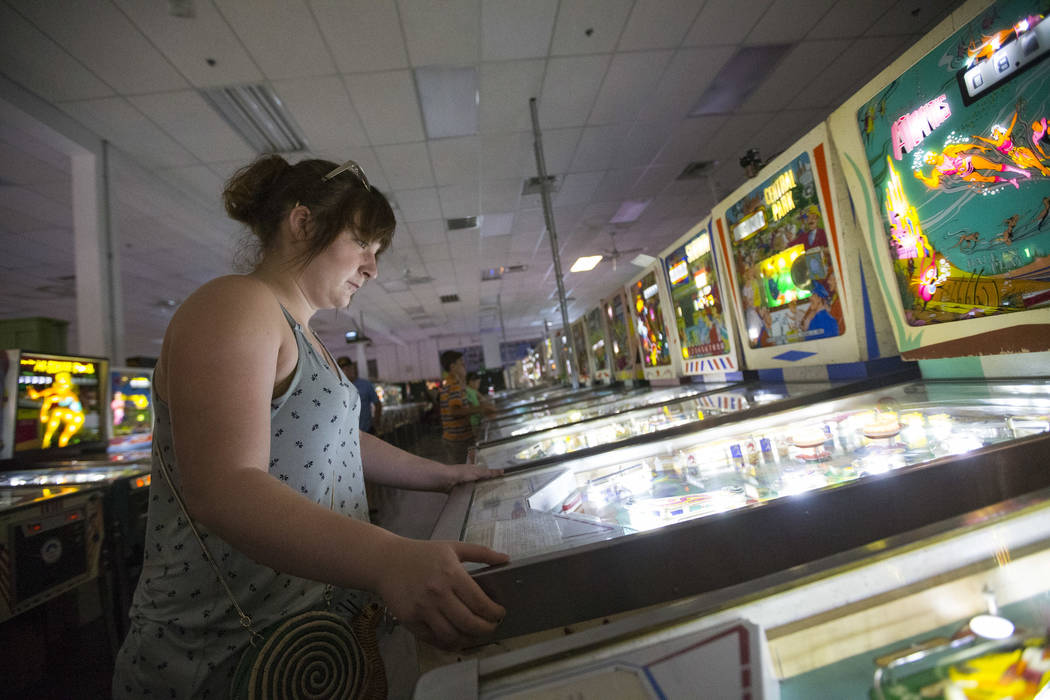 Abby Lammers of St. Louis, Missouri, plays the Atlantis pinball machine by Gottlieb during a visit to the Pinball Hall of Fame located at 1610 E. Tropicana Avenue in Las Vegas on Saturday, July 28 ...