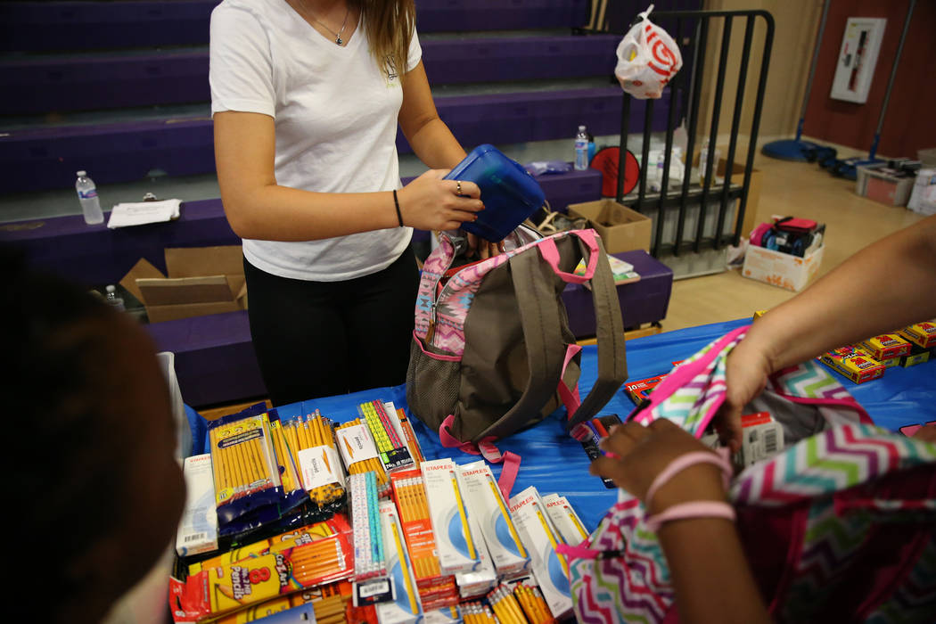 Foster children receive school supplies including a backpack during an event sponsored by Foster Change at the Clark County Family Services Department in Las Vegas, Thursday, July 26, 2018. Erik V ...