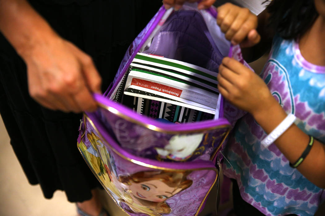 A foster child receives school supplies including a backpack during an event sponsored by Foster Change at the Clark County Family Services Department in Las Vegas, Thursday, July 26, 2018. Erik V ...