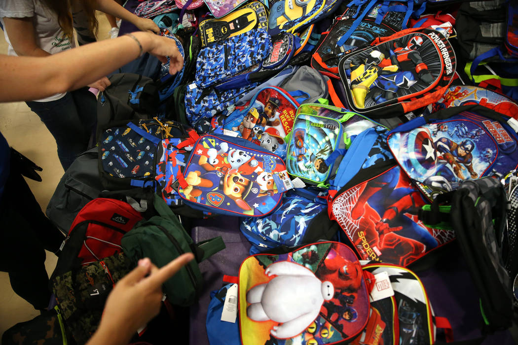 School backpacks for foster children during an event sponsored by Foster Change at the Clark County Family Services Department in Las Vegas, Thursday, July 26, 2018. Erik Verduzco Las Vegas Review ...