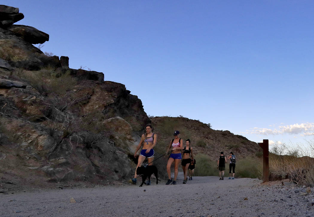 In this Tuesday, July 24, 2018 photo, hikers beat the heat on the trails at first light in Phoenix as temperatures exceed 95 degrees before sunrise. (AP Photo/Matt York)