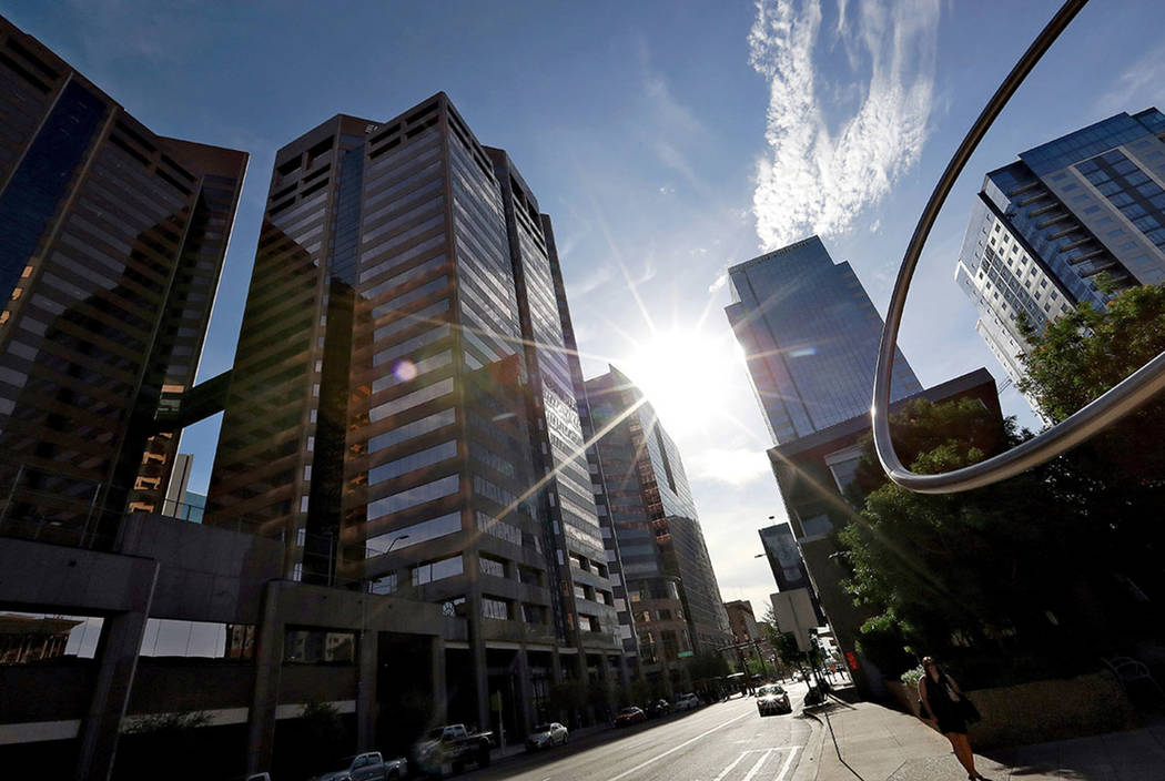 In this Monday, July 23, 2018 photo, the sun beats down on downtown Phoenix. (AP Photo/Matt York)